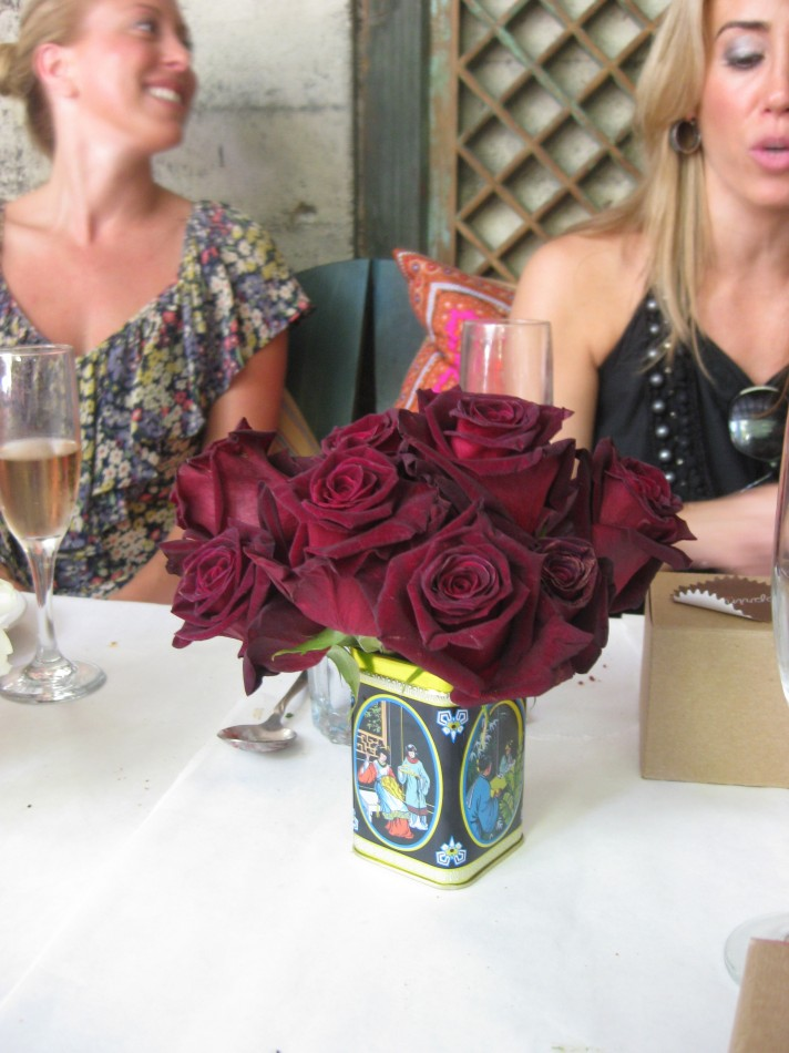 marron roses in a black tin
