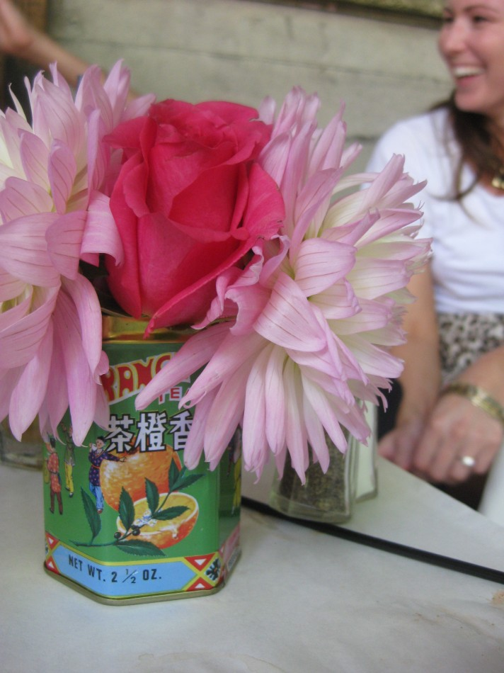 pink rose in green tea tin