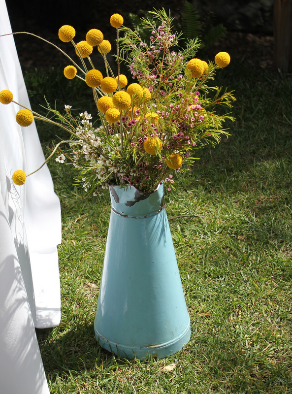 Turquoise pitcher with wildflowers